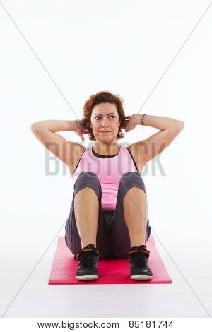 Mature woman working out