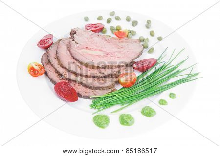 hot ham served on white dish isolated over white