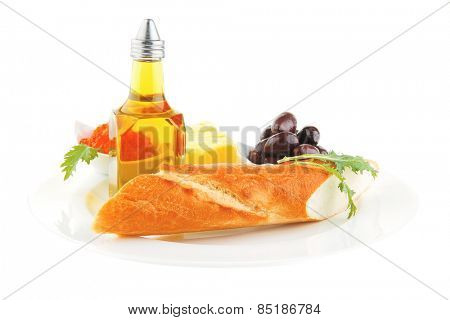 olive oil,caviar, and baguette on white plate