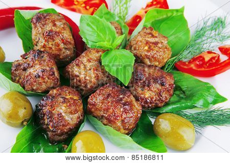 roasted cutlets served on basil with vegetables