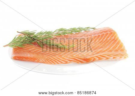 fresh uncooked salmon fillet with rosemary on white