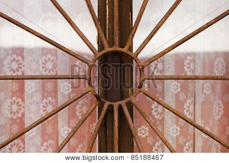 Rusty metal bars on a window