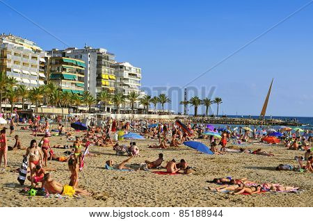 SALOU, SPAIN - AUGUST 24: Vacationers in Llevant Beach on August 24, 2014 in Salou, Spain. Salou is a major destination for sun and beach for European tourism with more than 50,000 accommodations