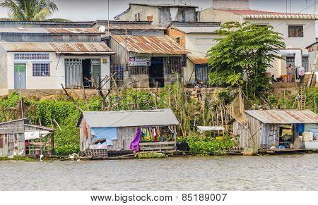PHNOM PENH, CAMBODIA, JANUARY 2, 2013: Floating village and fishing boats mooring at the riverside