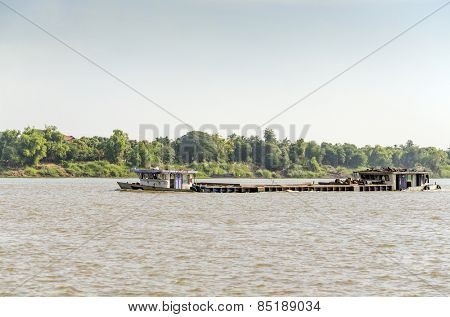 PHNOM PENH, CAMBODIA, JANUARY 2, 2013: A barge on Mekong river between Phnom Penh and Vietnam border