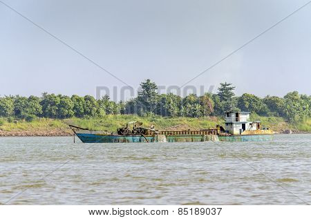 PHNOM PENH, CAMBODIA, JANUARY 2, 2013:A dredger on Mekong river between Phnom Penh and Vietnam border