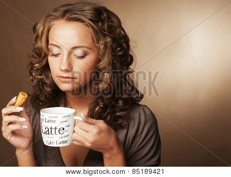 Young woman with an aromatic coffee in hands