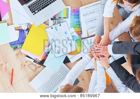 Business team with hands together - teamwork concepts .