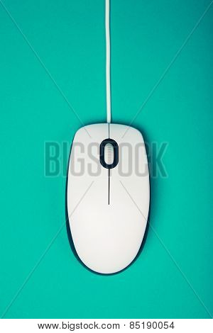 computer mouse on emerald background