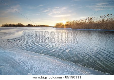 Winter landscape and icy river. Nature composition.