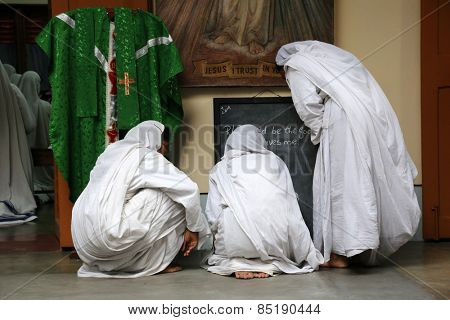 KOLKATA, INDIA - FEBRUARY 07: Sister of Missionaries of Charity preparing for prayer in Motherhouse, Kolkata, India on February 07, 2014.