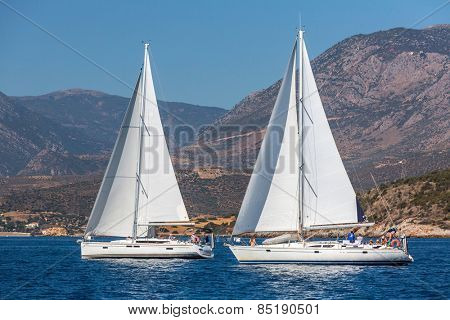 TRIZONIA, GREECE - CIRCA OCT, 2014: Unidentified sailors participate in sailing regatta 12th Ellada Autumn 2014 among Greek island group in the Aegean Sea, in Cyclades and Argo-Saronic Gulf.