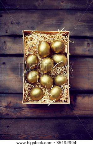 Box with painted golden eggs