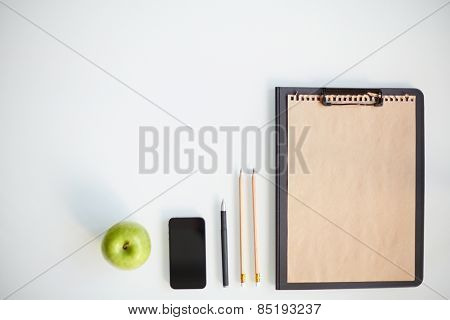 Writing instruments, smartphone, clipboard and apple