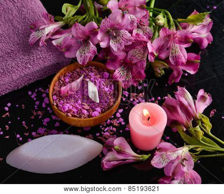 Spa set and orchid ,candle, salt with spoon in bowl ,towel ,bowl