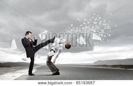 Two furious businessman fighting with each other