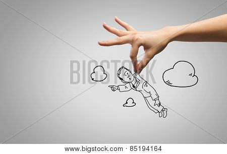 Close up of human hand and sketch of businessman
