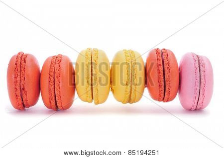 some appetizing macaroons with different colors and flavors on a white background