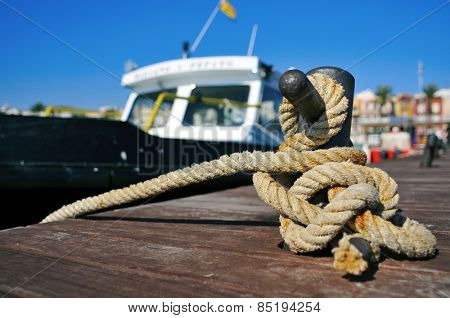 closeup of a boat tied with a rope on a mooring