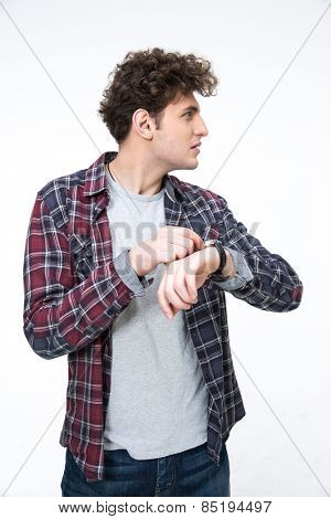 Portrait of a young man with wristwatch looking away