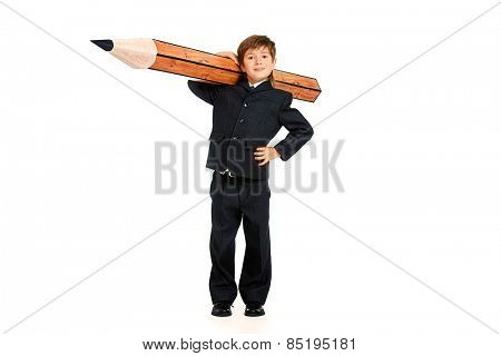 A boy in school uniform posing with a huge pencil. Educational concept. Isolated over white.