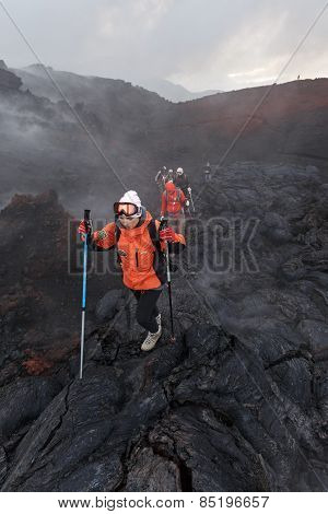 Group Of Tourists Hiking On The New Lava Field Eruption Tolbachik Volcano On Kamchatka. Russia