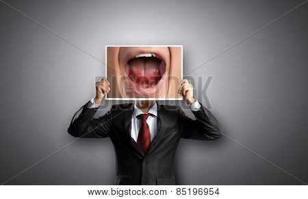 Unrecognizable businessman holding photo with screaming mouth