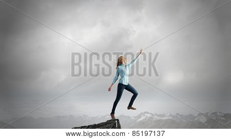 Young girl on edge making step above gap
