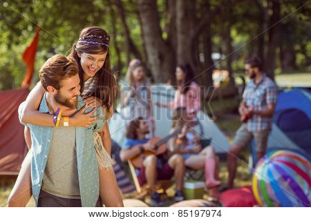 Hipster couple having fun on campsite at a music festival