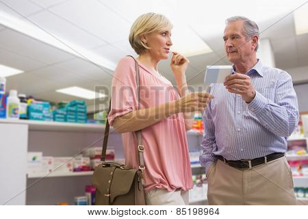 Couple speaking about medication in the pharmacy