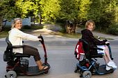 picture of scooter  - Two pretty young women on handicap scooters - JPG