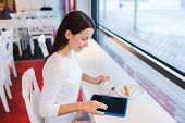Постер, плакат: leisure drinks people technology and lifestyle concept smiling young woman with tablet pc compu