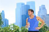 foto of bottle water  - Sport man drinking water bottle in New York City - JPG