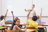 foto of pupils  - Pupils raising hand in classroom at the elementary school - JPG