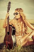 image of hippy  - Romantic girl travelling with her guitar - JPG