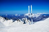 stock photo of caucus  - Panorama of ski pistes on top of the peak with skies put in the snow - JPG