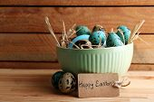 foto of bird egg  - Bird colorful eggs in bowl on wooden background - JPG