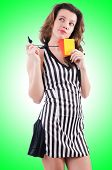 stock photo of referee  - Woman referee with card on white - JPG