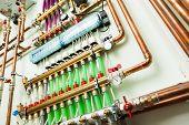 stock photo of boiler  - underfloor heating control system in boiler - JPG