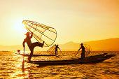 pic of fishermen  - Vintage retro effect filtered hipster style image of three Myanmar traditional Burmese fishermen at Inle lake - JPG