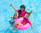 pic of swimming pool family  - Family with children in swimming pool - JPG