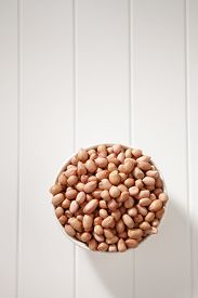 stock photo of ground nut  - top view of the ground nut in a white bowl - JPG