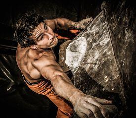 stock photo of rocking  - Muscular man practicing rock - JPG