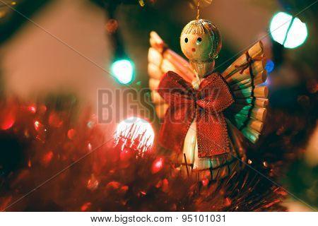 Cute Wooden Christmas Angel Hanging In Tree
