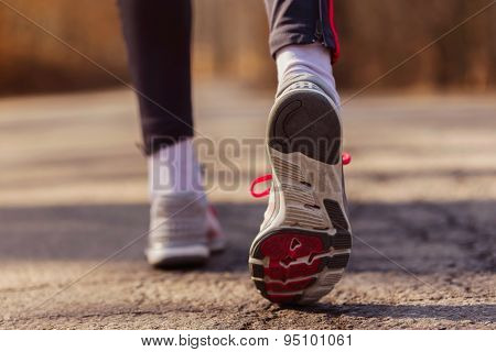 Runner Feet With Sport Shoes On Road