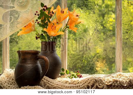 Asiatic Hybrids Orange Lilies Bouquet On A Window Sill In A Sunny Rainy Day. Good Mood Emotions Of O