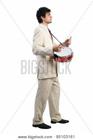 Businessman playing drums