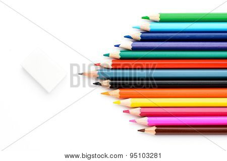 Colored pencils on a white piece of paper