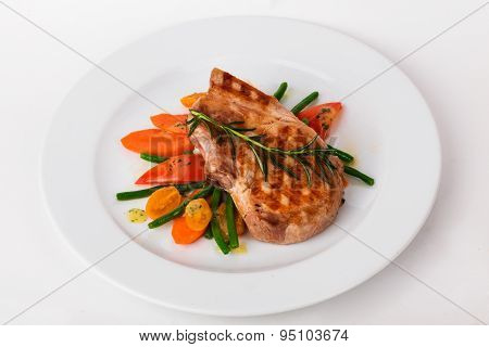 beautiful steak grilled cage with vegetables on a plate white background healthy dinner menu