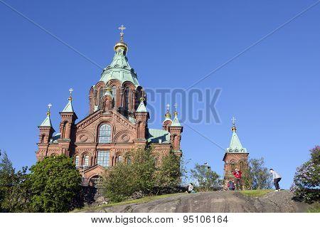 Tourists Take Photographs Near Uspenski Cathedral In Helsinki